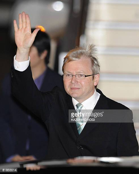 Australian Prime Minister Kevin Rudd waves to the press upon his arrival at New Chitose Airport in Hokkaido on July 8 2008 to attend the G8 Summit at...