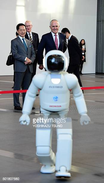 Australian Prime Minister Malcolm Turnbull , accompanied by museum head and former astronaut Mamoru Mori , watches a walking performance of Japanese...