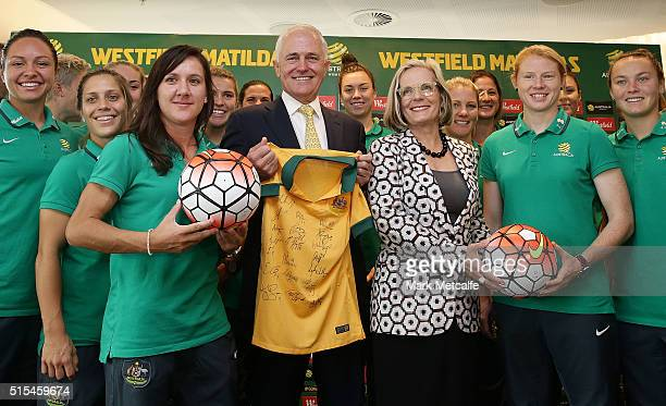 Australian Prime Minister Malcolm Turnbull and his with Lucy Turnbull pose with Matildas players during a welcome home function for the Australia...
