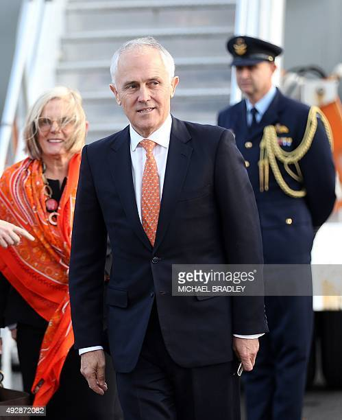 Australian Prime Minister Malcolm Turnbull arrives with his wife Lucy Turnbull at the Auckland International Airport on October 16 for his first...