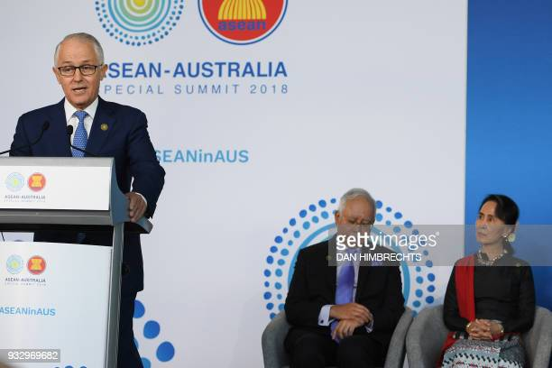 Australian Prime Minister Malcolm Turnbull delivers an address as Malaysian Prime Minister Najib Razak and Myanmar State Counsellor Aung San Suu Kyi...