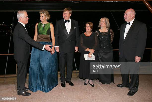 Australian Prime Minister Malcolm Turnbull gestures as he stands with King WillemAlexander of the Netherlands and his wife Queen Maxima his wife Lucy...