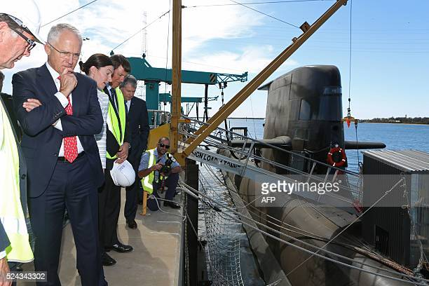 Australian Prime Minister Malcolm Turnbull looks at a Royal Australian Navy Collinsclass submarine at the ASC naval shipyards in Adelaide after...