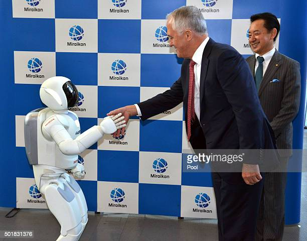 Australian Prime Minister Malcolm Turnbull meets the robot Asimo at the National Museum of Emerging Science and Innovation on December 18 2015 in...