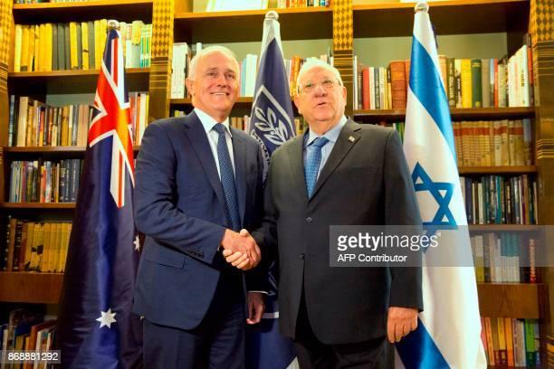 Australian Prime Minister Malcolm Turnbull shakes hands with Israeli President Reuven Rivlin in Jerusalem on November 1 2017 PHOTO / POOL / Ariel...