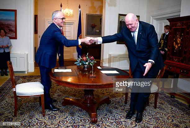 Australian Prime Minister Malcolm Turnbull shakes hands with the Australian Governor General Peter Cosgrove after he was officially sworn in during a...