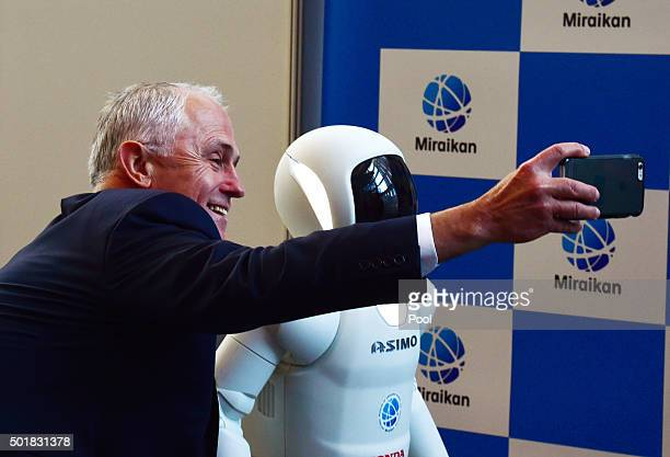 Australian Prime Minister Malcolm Turnbull takes a selfie photograph with the robot Asimo at the National Museum of Emerging Science and Innovation...