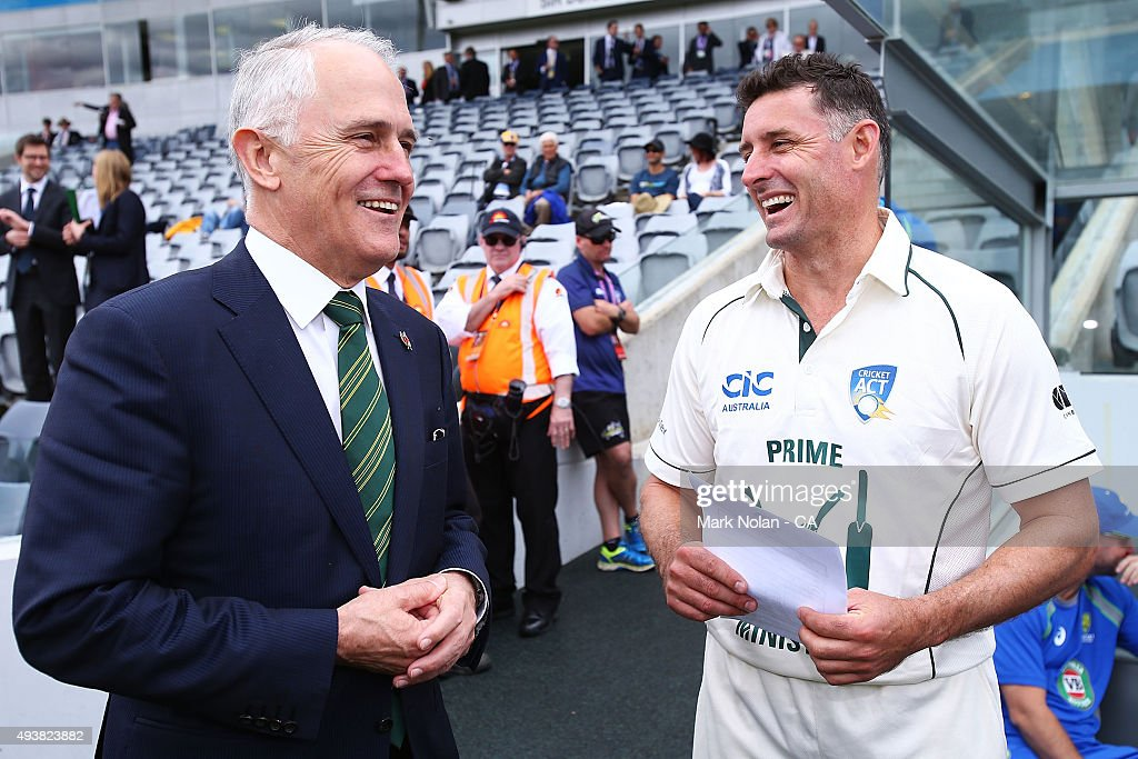 Australian Prime Minister Malcom Turnbull chats with Michael Hussey before the tour match between the Prime Minister's XI and New Zealand at Manuka Oval on October 23, 2015 in Canberra, Australia.