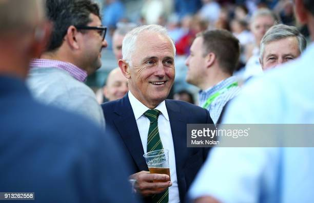 Australian Prime Minister Malcom Turnbull drinks with fans before the One Day Tour Match between the Prime Minister's XI and England at Manuka Oval...