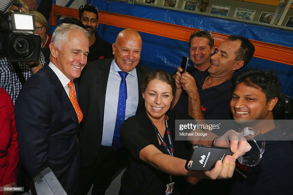 Australian Prime Minister Malcom Turnbull (L) poses for a selfie with employees from an Engineering Company in Moorabbin on May 12, 2016 in Melbourne, Australia. The Prime Minister has been named in the Panama Papers as a former director of British Virgin Islands company Star Technology Services Limited, which was set up and administered by the law firm Mossack Fonseca in the 1990s. Mr Turnbull resigned from the company in 1995.