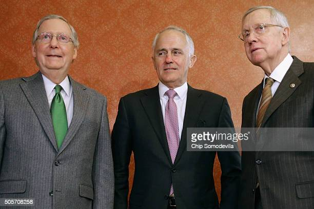 Australian Prime Minister Malcom Turnbull poses for photographs with Senate Majority Leader Mitch McConnell and Senate Minority Leader Harry Reid in...