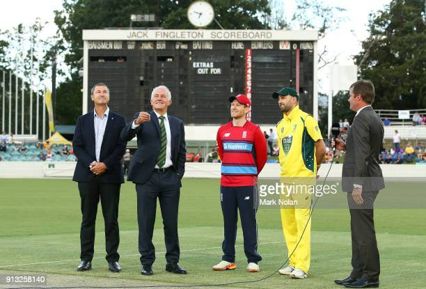 Australian Prime Minister Malcom Turnbull takes part in the coin toss before the One Day Tour Match between the Prime Minister's XI and England at...