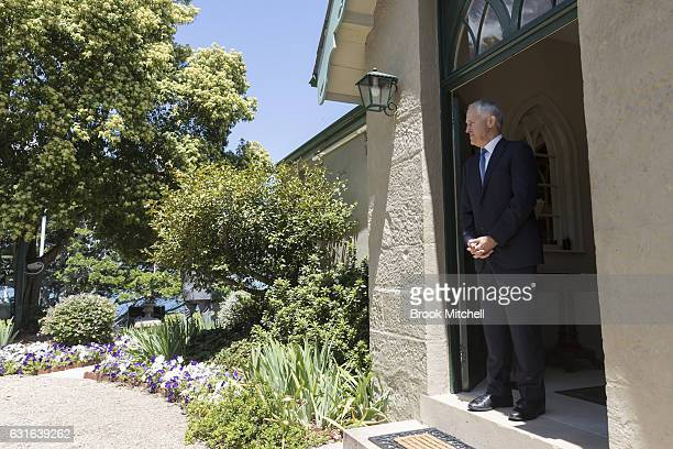 Australian Prime Minister Malcom Turnbull waits to greet Japanese Prime Minister Shinzo Abe for a bilateral meeting at Kirribilli House on on January...
