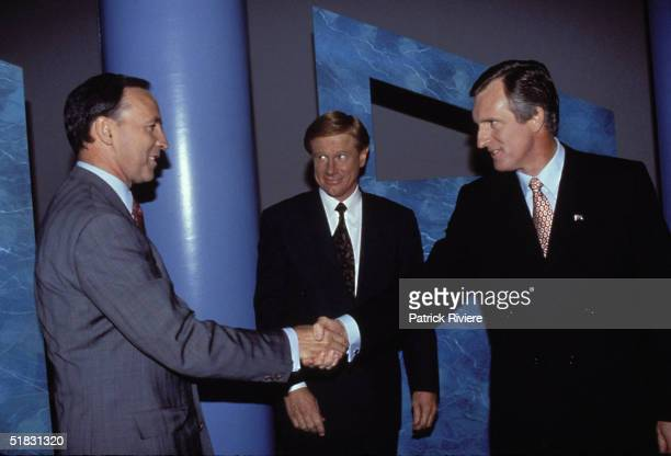 Australian Prime Minister Paul Keating shakes hand with Leader of the opposition Dr John Hewson watched by Moderator Kerry O'Brien at the start of...