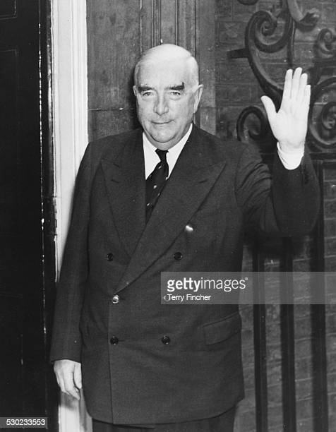 Australian Prime Minister Robert Menzies waving as he arrives at 10 Downing Street attending a meeting on the Suez Crisis London August 17th 1956