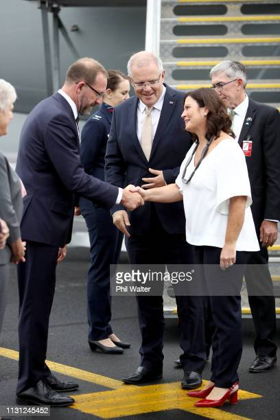 Australian Prime Minister Scott Morrison and his wife Jenny Morrison are greeted by Labour Party MP Andrew Little as they arrive at Auckland...