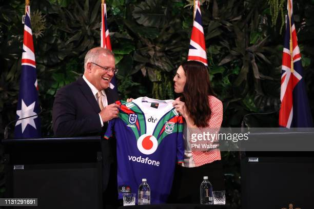 Australian Prime Minister Scott Morrison is presented with a NZ Warriors NRL jersey by New Zealand Prime Minister Jacinda Ardern after holding a...