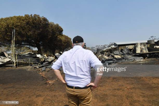 Australian Prime Minister Scott Morrison is seen visiting a fire damaged property on Stokes Bay on Kangaroo Island southwest of Adelaide Wednesday...
