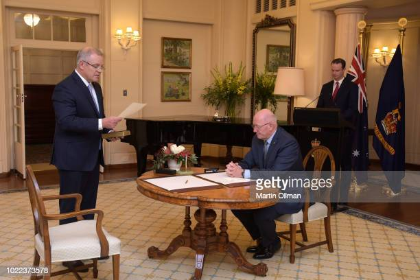Australian Prime Minister Scott Morrison is sworn in by Australia's Governor-General Sir Peter Cosgrove as Australia's 30th Prime Minister at...