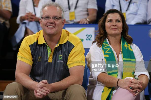 Australian Prime Minister Scott Morrison looks on with his wife Jennifer during the 2019 Constellation Cup match between the Australia Diamonds and...