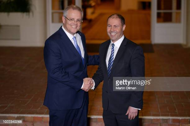 Australian Prime Minister Scott Morrison poses with Australian Treasurer Josh Frydenberg after being sworn in by Australia's GovernorGeneral Sir...