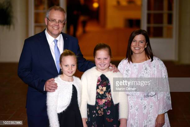 Australian Prime Minister Scott Morrison poses with his wife Jenny Morrison after being sworn in by Australia's GovernorGeneral Sir Peter Cosgrove as...