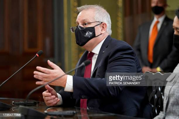 Australian Prime Minister Scott Morrison speaks as he meets with Vice President Kamala Harris and Japanese Prime Minister Yoshihide Suga in the Vice...