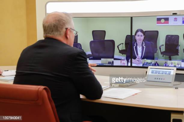 Australian Prime Minister Scott Morrison speaks with NSW Premier Gladys Berejiklian during a National Cabinet meeting to discuss COVID19 from the...