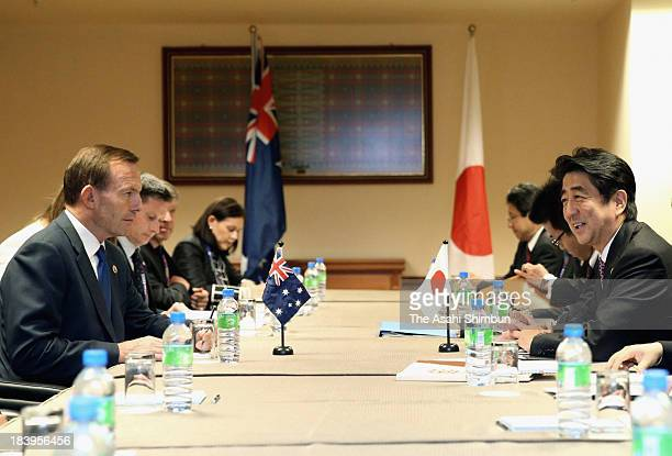 Australian Prime Minister Tonny Abbott and Japan Prime Minister Shinzo Abe talk at the toplevel meeting held during ASEAN Plus Three Summit on...
