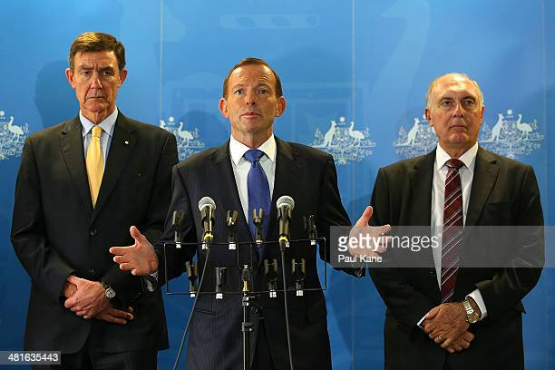 Australian Prime Minister Tony Abbott addresses the media together with former Defence Force Chief Angus Houston and Deputy Prime Minister Warren...