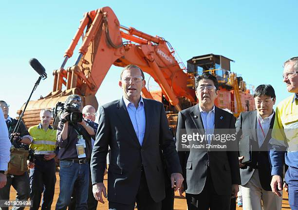 Australian Prime Minister Tony Abbott and Japanese Prime Minister Shinzo Abe inspect during a tour of the Rio Tinto West Angelas iron ore mine in the...