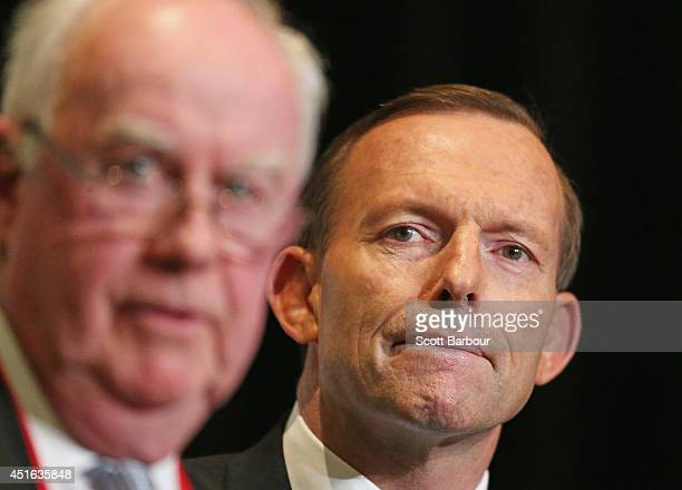 Australian Prime Minister Tony Abbott and Paul Kelly EditoratLarge of The Australian newspaper look on during the 2014 Economic and Social Outlook...
