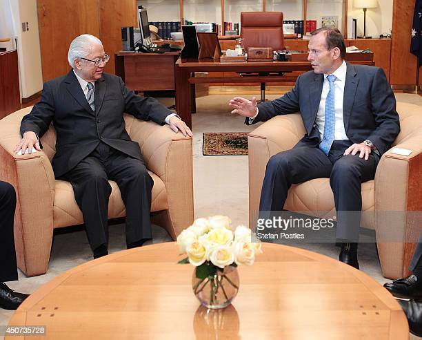 Australian Prime Minister Tony Abbott and Singapore President Tony Tan Keng Yam talk inside the Prime Ministers office at Parliament House on June 17...