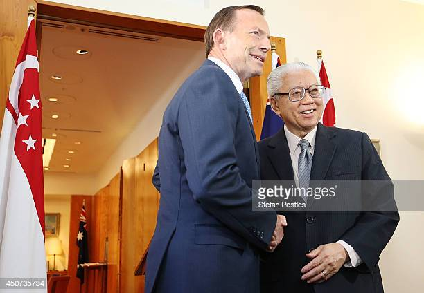 Australian Prime Minister Tony Abbott and Singapore President Tony Tan Keng Yam pose for the media at Parliament House on June 17, 2014 in Canberra,...