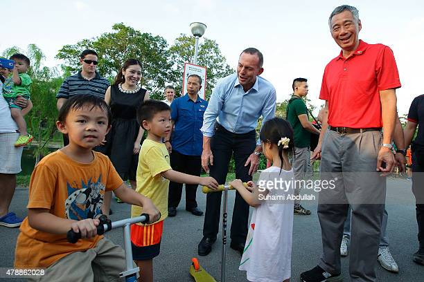 Australian Prime Minister Tony Abbott and Singapore Prime Minister Lee Hsien Loong mingle with residents while on tour at Bishan Park on June 28 2015...