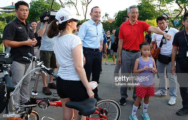Australian Prime Minister Tony Abbott and Singapore Prime Minister Lee Hsien Loong mingles with residents while on tour at Bishan Park on June 28...