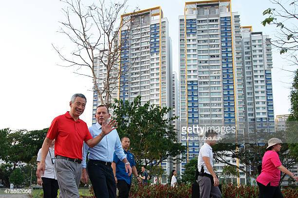 Australian Prime Minister Tony Abbott and Singapore Prime Minister Lee Hsien Loong tour Bishan Park on June 28 2015 in Singapore Australian Prime...