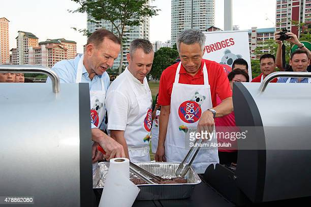 Australian Prime Minister Tony Abbott and Singapore Prime Minister Lee Hsien Loong join in a barbecue session as part of an Australian High...