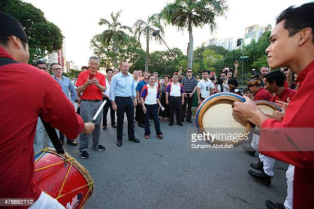 Australian Prime Minister Tony Abbott and Singapore Prime Minister Lee Hsien Loong are welcomed by the Malay kompang players while on tour at Bishan...