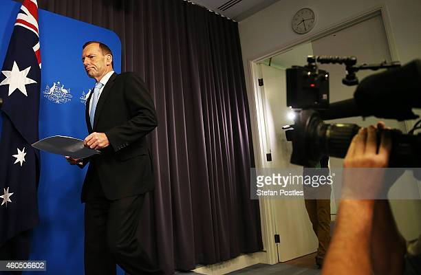 Australian Prime Minister Tony Abbott arrives to give a statement about the hostage situation to the media at Parliament House on December 16 2014 in...