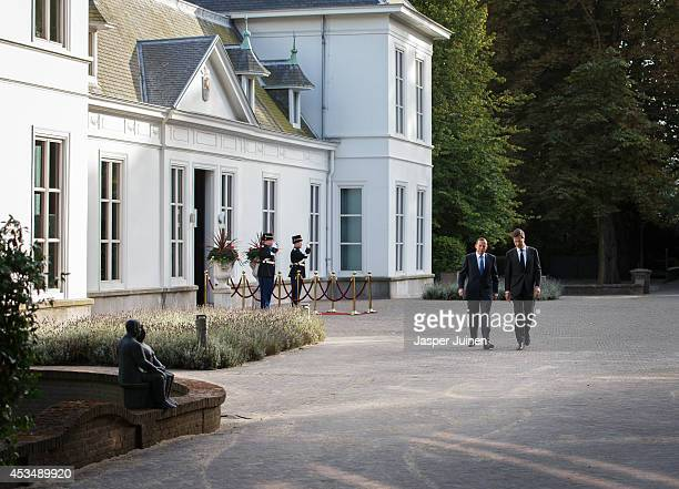 Australian Prime Minister Tony Abbott chats with Dutch Prime Minister Mark Rutte as they walk the Catshuis residence garden on their way to give a...
