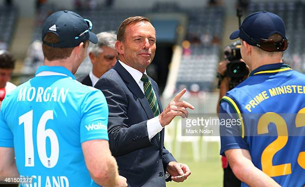 Australian Prime Minister Tony Abbott chats with English captain Eoin Morgan and the PMs XI captain Chris Rogers before the tour match between the...