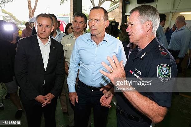 Australian Prime Minister Tony Abbott chats with South Australia Premier Jay Weatherill and South Australian Police Commissioner Gary Burns on...