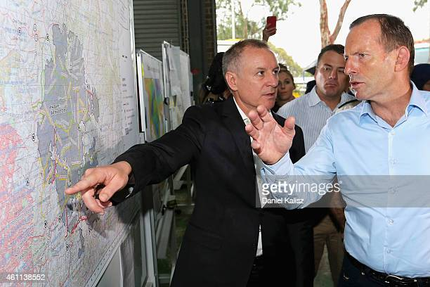 Australian Prime Minister Tony Abbott chats with South Australia Premier Jay Weatherill on January 8 2015 in Adelaide Australia Prime Minister Abbott...