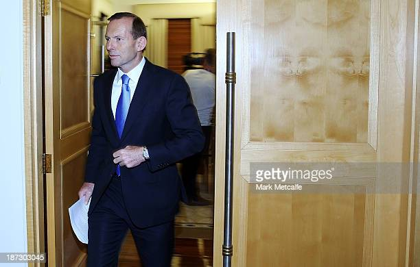 Australian Prime Minister Tony Abbott departs from a press conference on November 8 2013 in Melbourne Australia Abbott today announced the government...