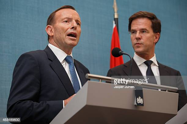 Australian Prime Minister Tony Abbott gives a statement next to Dutch Prime Minister Mark Rutte at the Catshuis on August 11 2014 in The Hague...