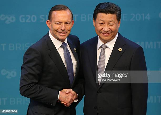 Australian Prime Minister Tony Abbott greets Chinese President Xi Jinping during the official welcome at the Brisbane Convention and Exhibitions...