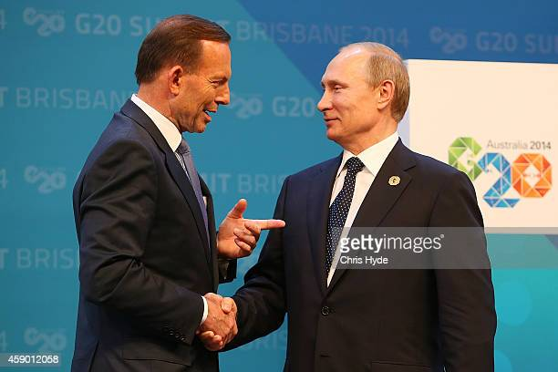 Australian Prime Minister Tony Abbott greets Russia's President Vladimir Putin during the official welcome at the Brisbane Convention and Exhibitions...