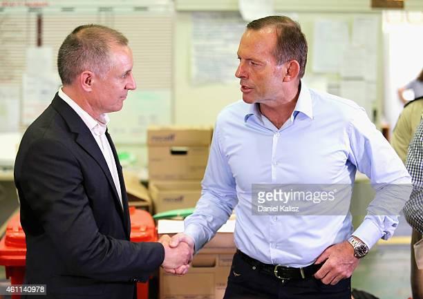 Australian Prime Minister Tony Abbott greets South Australia Premier Jay Weatherill on January 8 2015 in Adelaide Australia Prime Minister Abbott...