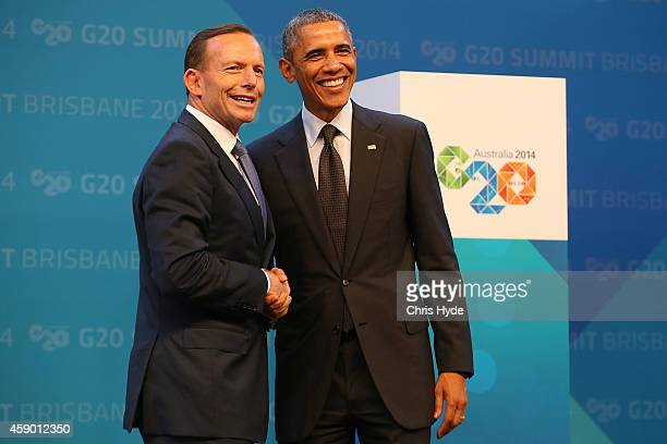 Australian Prime Minister Tony Abbott greets United States President Barack Obama during the official welcome at the Brisbane Convention and...